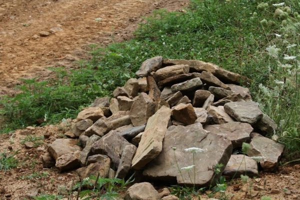 The rock pile for culvert retaining wall.