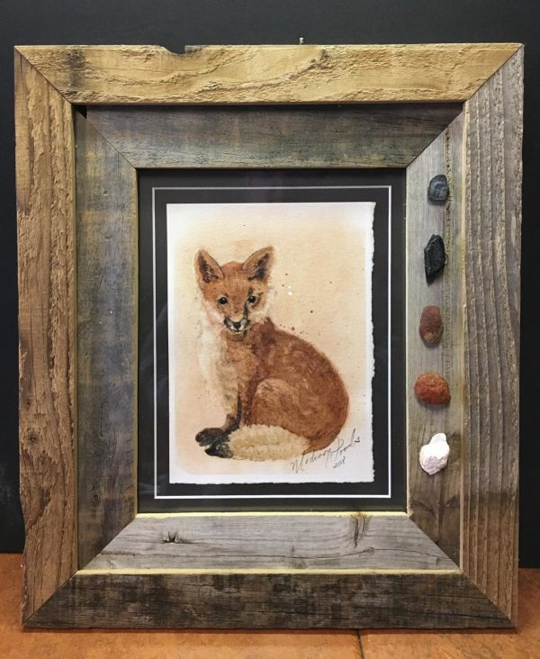 My red fox painting, framed in old barnwood with rock pigment specimens.