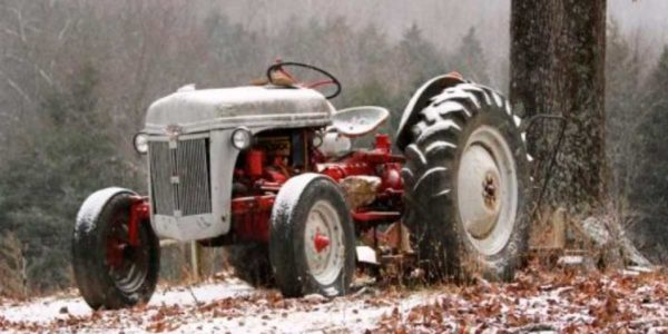 The old Ford tractor in winter.