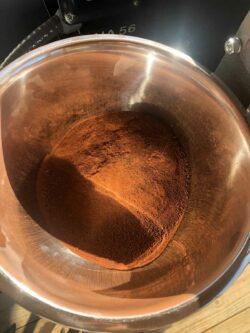 A pan of freshly ground pigment from reddish Ozark sandstone.