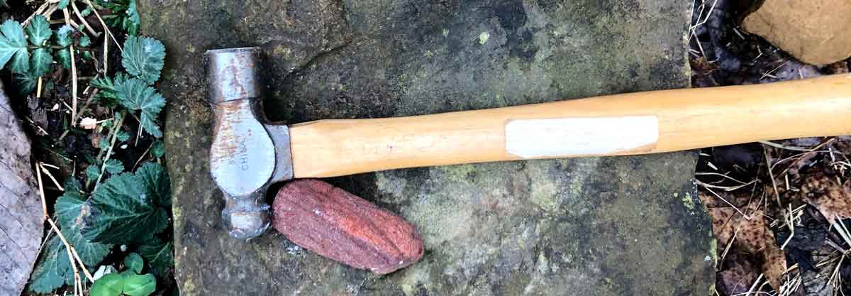 The hammer and rock I use to crush rocks to smaller chunks before making paint from rock dust.