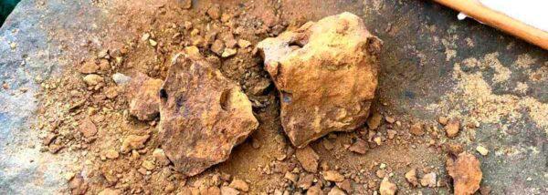 Crushed and broken yellow rocks.